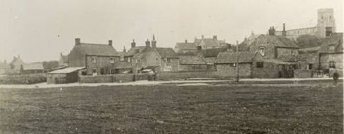 houses on the village green before they were damaged by the 1953 flood