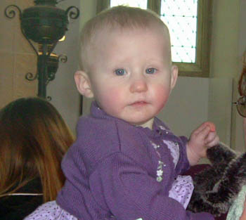 Elektra at her Baptism in Salthouse St Nicholas Church on  22nd February 2009