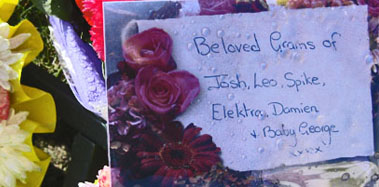 the card on the floral tribute from her grandchildren