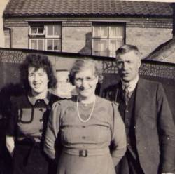 Joan Brown with her parents Evangeline and Charlie Brown