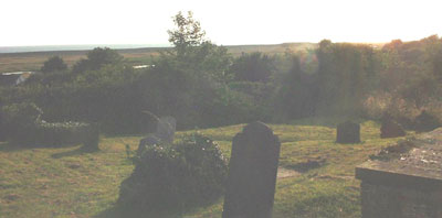 A part of the graveyard to the north of Salthouse church, overlooking the sea